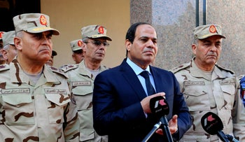 egyptian President Abdel-Fattah el-Sisi (C), surrounded by top military generals, as he addresses journalists following an emergency meeting of the Supreme Council of the armed Forces in Cairo on January 31, 2015