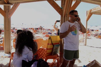 Robby Berman, the organizer of the beach trips, speaks on the phone.