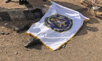 A victim is covered by the flag of the Southern Transitional Council at the scene of a Houthi missile attack, Aden, Yemen, August 1, 2019