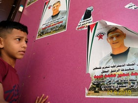 Mohammed Obeid's picture on a door, his brother next to it.