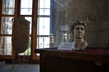 An ancient bust of King David is displayed inside the historical Pasha Palace in Gaza City, July 16, 2019.