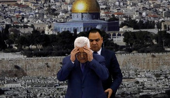 Palestinian President Mahmoud Abbas praying at the start of a cabinet meeting,  Ramallah, July 25, 2019.