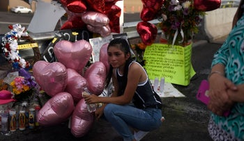 A high school student mourns for her classmate as people pay their respects four days after a mass shooting in El Paso, Texas, August 7, 2019.
