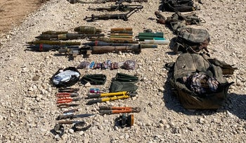 Weapons that the Israeli military says it captured from Gazans attempting to cross border on August 10, 2019.