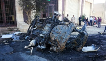 People gather at the site where a car bomb exploded in Benghazi, Libya August 10, 2019.