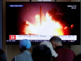 People watch a news program reporting about North Korea's projectiles with a file image at the Seoul Railway Station in Seoul, South Korea, Saturday, August 10, 2019.