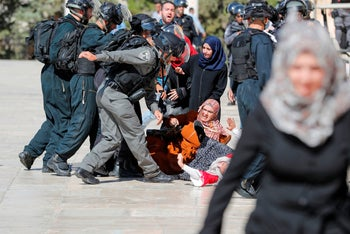 Israeli security forces scuffle with Palestinians at the al-Aqsa Mosque compound in the Old City of Jerusalem on August 11, 2019.