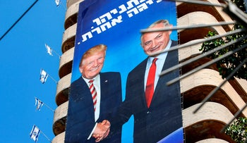 Likud Party election banners showing Israeli Prime Minister Benjamin Netanyahu shaking hands with US President Donald Trump, captioned in Hebrew: 'Netanyahu, another league.' Tel Aviv, July 28, 2019