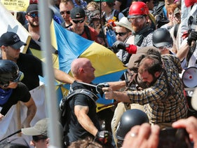File photo: White nationalist demonstrators clash with counter demonstrators at the entrance to Lee Park in Charlottesville, Virginia, August 12, 2017.