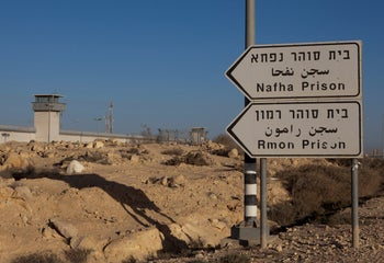A sign directing toward Israel's Ramon Prison and  Nafha Prison, which are next to each other, close to Mitzpe Ramon in southern Israel, January 2019.