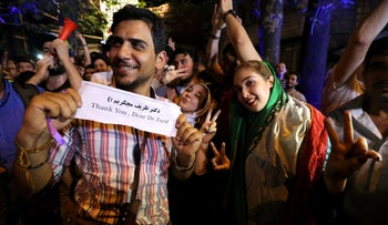 Iranians gather in celebration in northern Tehran on July 14, 2015, after Iran's nuclear negotiating team struck a deal with world powers in Vienna