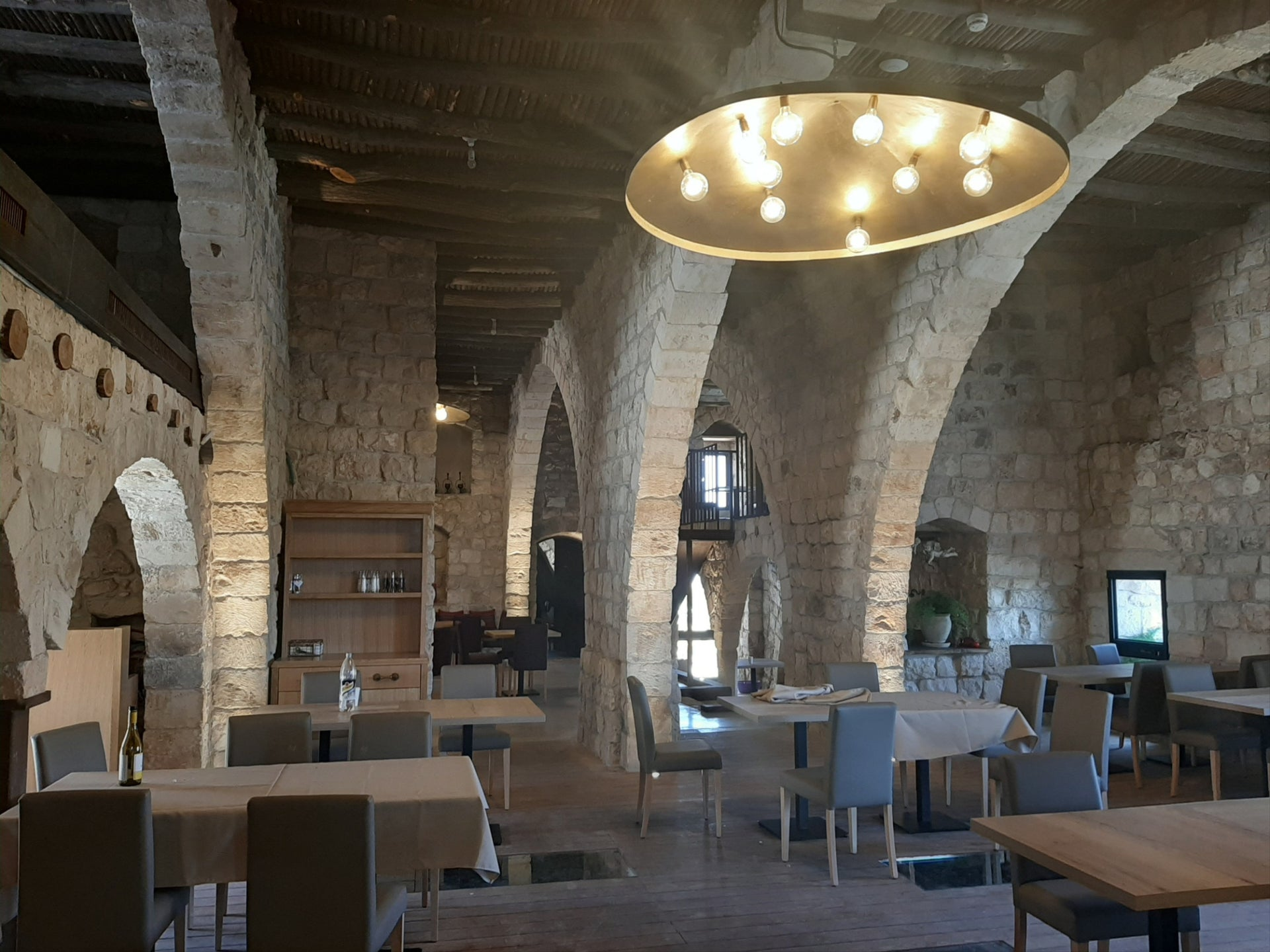 Inside Salma Assaf's restaurant: Note the windows on the floor, with a view of the Crusader-era winery.