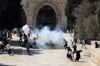 Stun grenades explode as Israeli police clash with Palestinian worshipers on the Temple Mount, in Jerusalem's Old City, August 11, 2019.