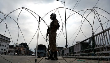A Indian security personnel stands guard on a street during a lockdown in Srinagar on August 11, 2019, after the Indian government stripped Jammu and Kashmir of its autonomy