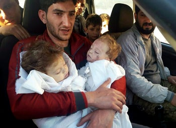 Abdel Hamid al-Yousef holds his twin babies who were killed during a suspected chemical weapons attack in Khan Sheikhoun, Syria, April 4, 2017.