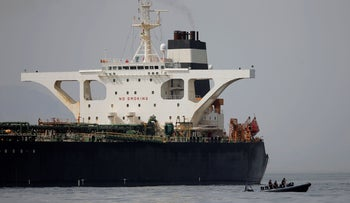 Gibraltar defense police officers guard the Iranian oil tanker Grace 1 as it sits anchored after it was seized, southern Spain, July 20, 2019.