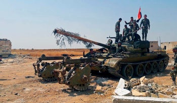 Syrian army soldiers flash the victory in northwestern Syria, August 13, 2019.