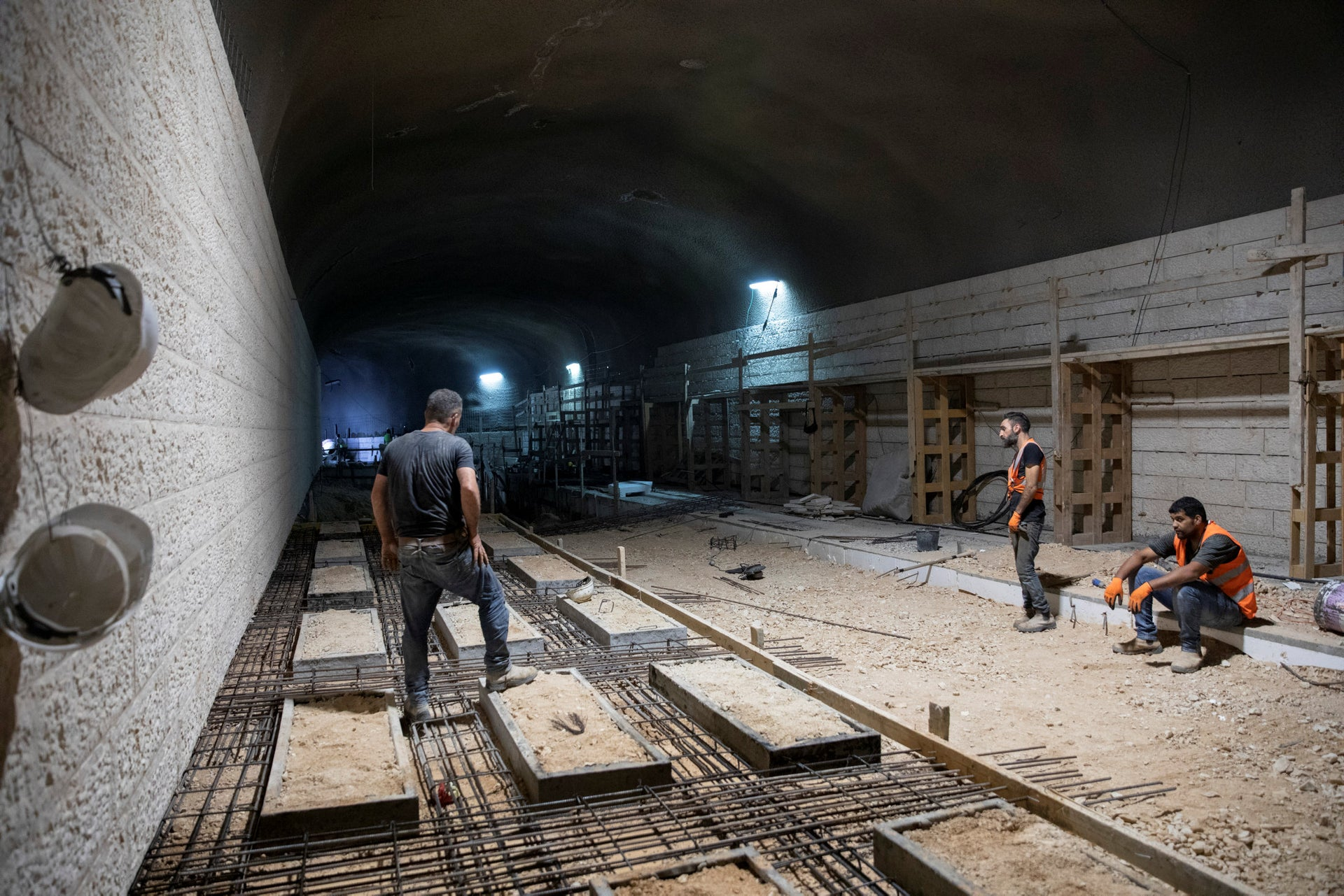 Construction workers at work on the underground cemetery being built at Jerusalem's Har Mamenuchot.