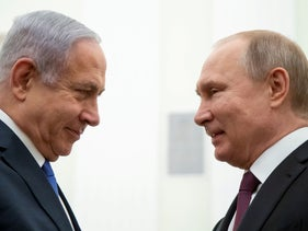Prime Minister Benjamin Netanyahu and Russian President Vladimir Putin greeting each other during their meeting in the Kremlin in Moscow, April 4, 2019.