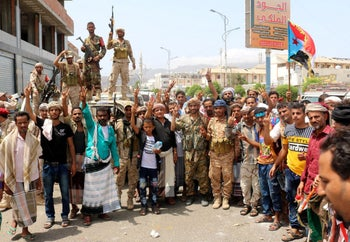 Yemeni Southern separatists supporters wave a flag of the former South Yemen in Aden, August 15, 2019.