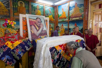 Jetsun Pema pays her respects in front of a portrait of her brother, Tibetan spiritual leader the Dalai Lama, on his 84th birthday. Tsuglakhang temple in Dharmsala, India, July 6, 2019