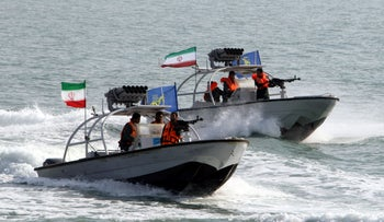 Iranian Revolutionary Guards drive speedboats at the port of Bandar Abbas in July, 2012.