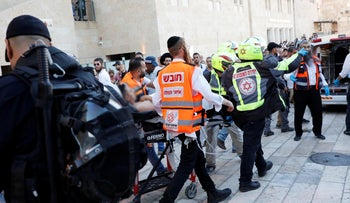 Paramedics evacuating a man wounded in a stabbing in the Old City in Jerusalem, August 15, 2019