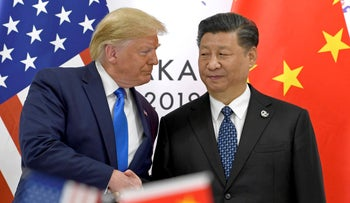 Trump shakes hands with Xi Jinping during a meeting on the sidelines of the G-20 summit in Osaka, Japan, June 29, 2019.
