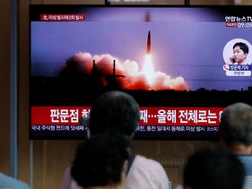 People watch a TV news program reporting about North Korea's firing projectiles with a file image at the Seoul Railway Station in Seoul, South Korea, August 16, 2019.