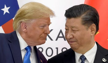 President Donald Trump, left, meets with Chinese President Xi Jinping during a meeting on the sidelines of the G-20 summit in Osaka, Japan, June 29, 2019.