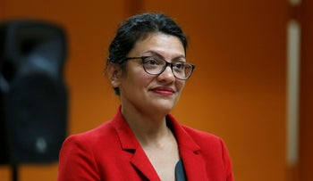 U.S. Congresswoman Rashida Tlaib listens to a question from a constituent during a Town Hall style meeting in Inkster, Michigan, U.S. August 15, 2019.