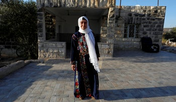 Muftia, the grandmother of U.S. congresswoman Rashida Tlaib, poses for a photo in front of her house in the West Bank, August 2019.