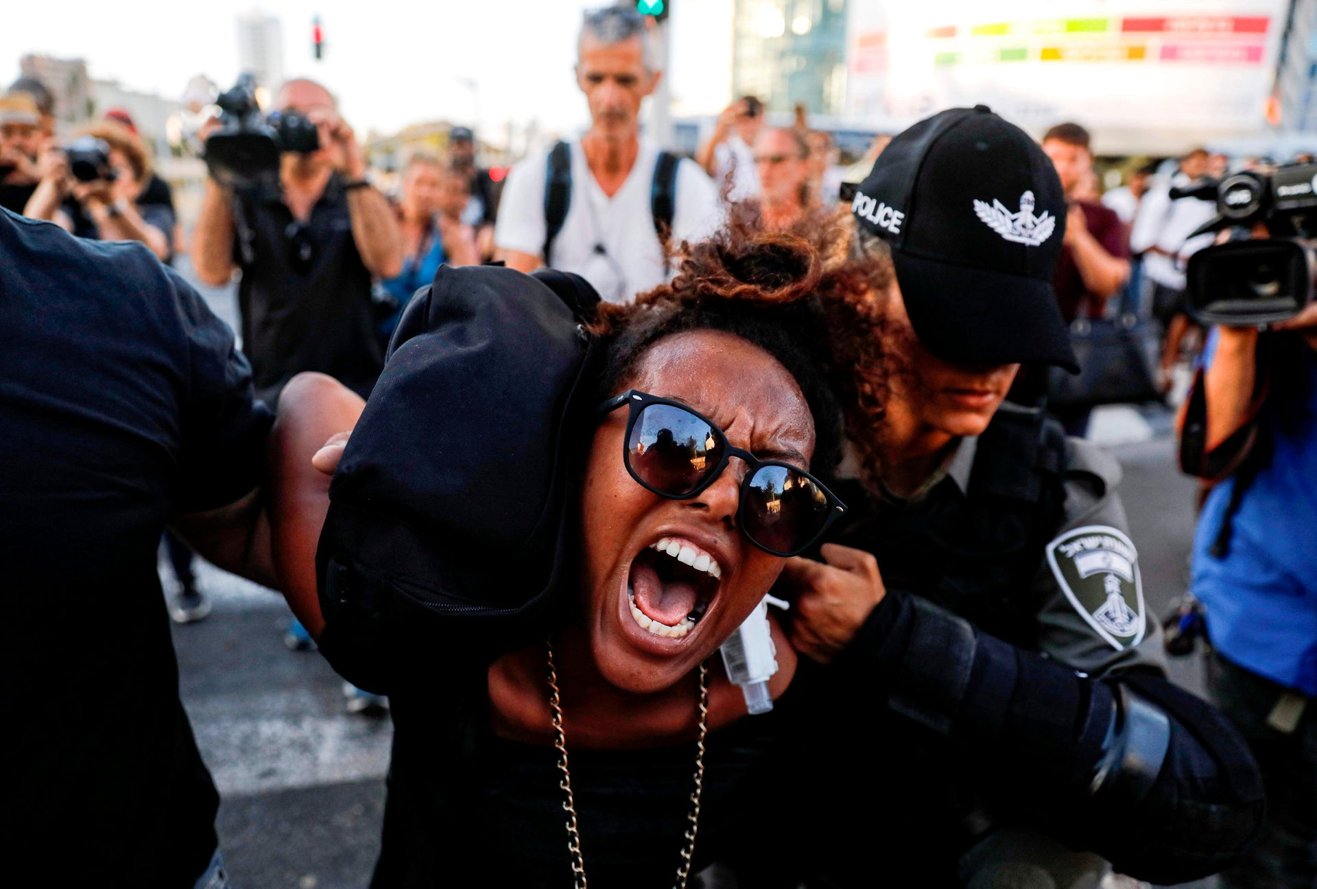 Members of the security forces detaining a protester during a demonstration against police brutality against Ethiopian Israelis, Tel Aviv, July 3, 2019.