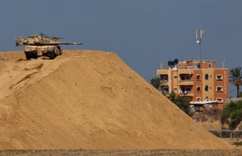 An Israeli tank on the border opposite the Gaza town of Dir al-Balah.