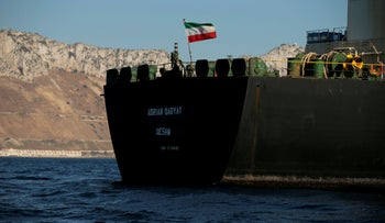 The Iranian flag flies on board the Iranian oil tanker Adrian Darya 1, Gibraltar, August 18, 2019.