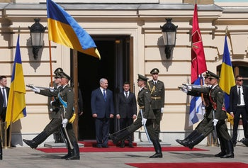 Ukrainian President Volodymyr Zelensky, right, and Israeli Prime Minister Benjamin Netanyahu watch as the guard of honor march past during their meeting in Kiev, Ukraine, August 19, 2019.
