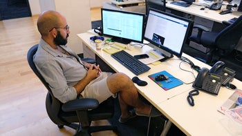 An Israeli man rocking his shorts at the office. A particular point of contention.