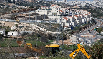 An Israeli machinery removes trees near a Jewish settlement in Hebron, February 21, 2018.