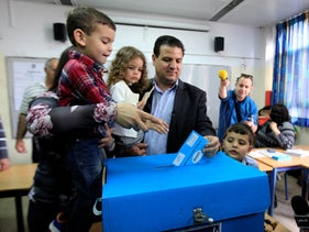 Arab Israeli lawmaker Ayman Odeh, the chairman of the Joint List, casts his ballot in Haifa, Israel,    on March 17, 2015.