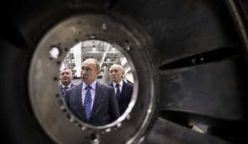 Vladimir Putin inspects an assembly department of the Ufa Engine Industrial Association plant in Ufa, January 24, 2018.