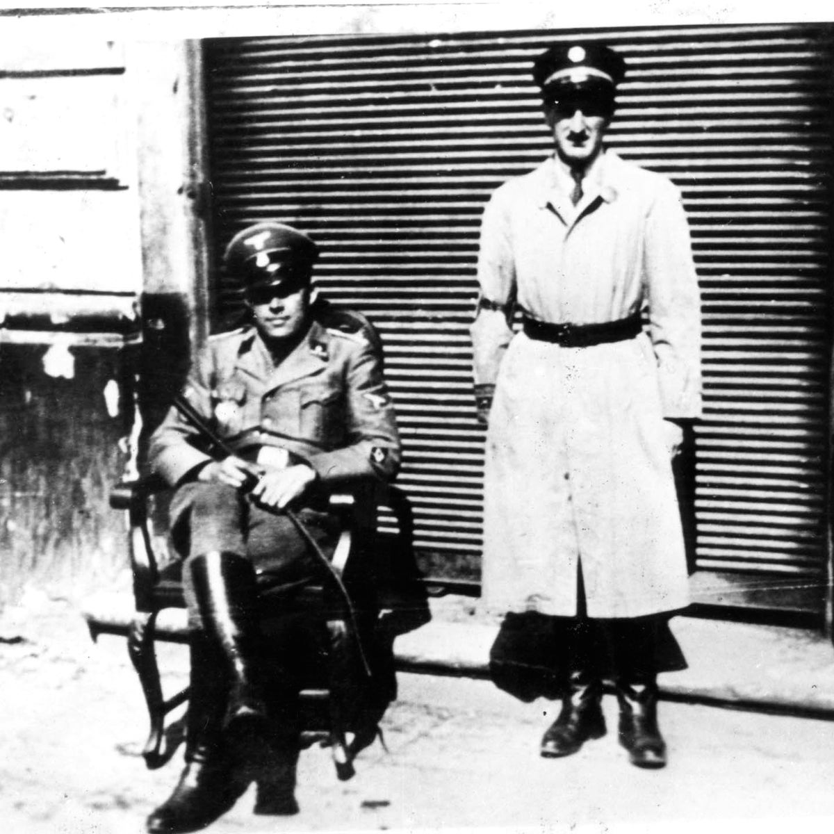 A Jewish policeman and a German soldier in the Warsaw Ghetto, in 1942.