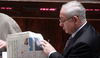 Benjamin Netanyahu reads an issue of TheMarker.