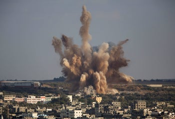 Smoke rises in Gaza City after an Israeli airstrike, August 9, 2014.