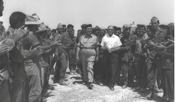 Levi Eshkol and Menachem Begin with soldiers in Sinai in 1967.