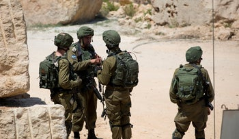 Israeli army forces patrolling near the area of the explosion, west of the West Bank city of Ramallah, August 24, 2019.