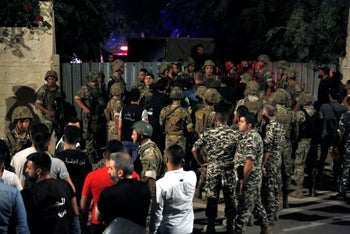Lebanese security stand near the site where an Israeli drone was said to have crashed in a suburb of Beirut,  August 25, 2019.
