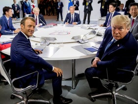 French President Emmanuel Macron and President Donald Trump participate in the G-7 summit in Biarritz, France, August 25, 2019.