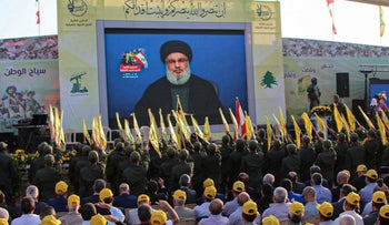 Hezbollah supporters gather to watch Nasrallah's speech in the town of Al-Ain, Lebanon, August 25, 2019.
