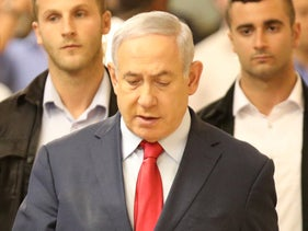 Netanyahu followed by  his security detail immediately after the vote to dissolve the Knesset and head to a second election, May 29, 2019.