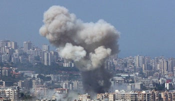 File photo: Smoke rises from a Hezbollah stronghold in southern Beirut after an Israeli air strike, July 19, 2006.
